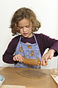 Little girl rolling dough with wooden rolling pin - LAF000442