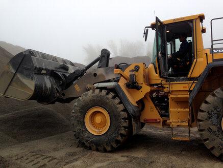 Wheel loader with gravel, Switzerland, Thurgau, Eschenz - JED000098