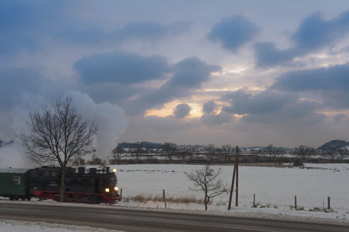 Germany, Mecklenburg-Western Pomerania, Ruegen, Steam train Rasender Roland in winter - MJ000633