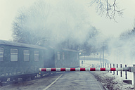 Germany, Mecklenburg-Western Pomerania, Ruegen, Steam train Rasender Roland in winter - MJ000597