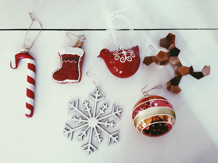 Mix of red Christmas ornaments on a white table, Bonn, Germany - MFF000798