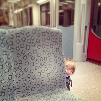 Toddler playing Peekaboo in the Subway, Berlin, Germany - MVC000064