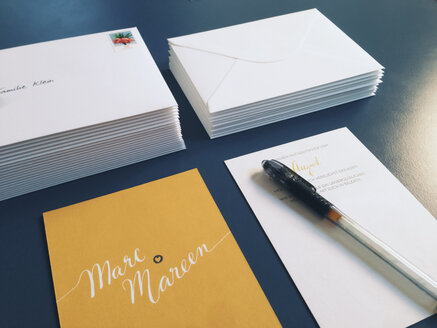 Wedding invitations and envelopes laying on a table, Bonn, Germany - MF000779