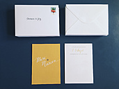 Wedding invitations and envelopes laying on a table, Bonn, Germany - MF000780