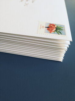 Envelopes with stamps 60ct laying on a table - MF000783