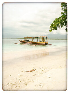 Indonesia, Gili Islands, Beach with traditional fishing boat - KRPF000107