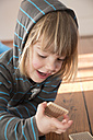 Little girl with hoodie sweater playing memory - LV000489
