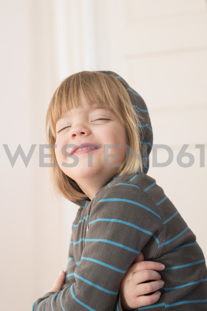 Portrait of smiling little girl with closed eyes wearing hoodie sweater - LVF000491