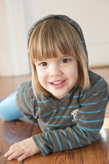 Portrait of smiling little girl with hoodie sweater - LVF000492