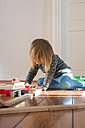 Little girl playing with wooden railroad - LV000496