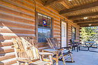 USA, Texas, Veranda of a  log house with wooden chairs - ABAF001184