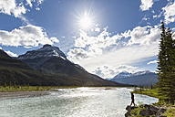 Canada, Alberta, Jasper National Park, Banff National Park, Icefields Parkway, man standing at riverbank - FOF005712
