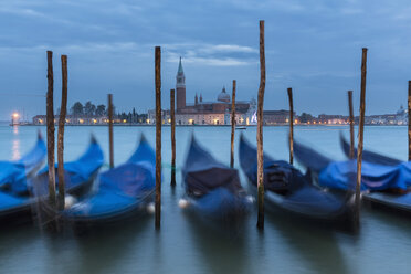 Italy, Venice, Gondolas at San Giorgio Maggiore at night - FOF005643