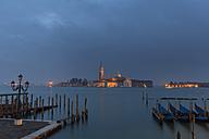 Italy, Venice, Gondolas at San Giorgio Maggiore at night - FOF005650