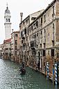 Italy, Veneto, Venice, Gondola with tourists on canal - FO005888