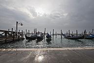 Italy, Venice, Gondolas and church San Giorgio Maggiore at high watermark - FO005943