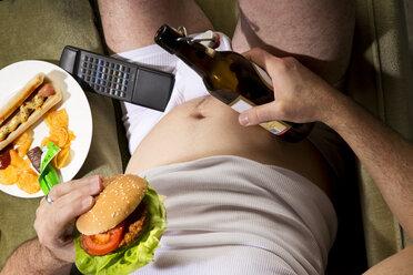 A man eats junk food - MAEF007682