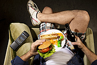 A man eats junk food - MAEF007685