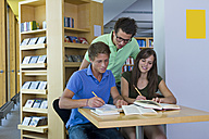 Germany, Baden-Wuertemberg, three students learning in a library - CHAF000104