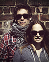 Portrait of young couple wearing wooden sunglasses - HOHF000407
