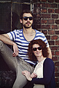 Portrait of young couple wearing wooden sunglasses - HOHF000404