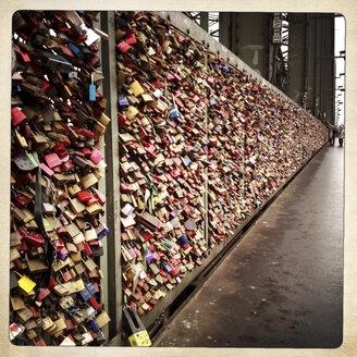 Love locks on the Hohenzollern Bridge. All 400 meters of the bridge are full of security locks by loving couples. Cologne, Germany. - ZM000158