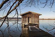 Germany, Bavaria, Upper Bavaria, View of boathouse at Lake Kochelsee - LAF000510