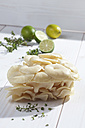 Golden Oyster Mushrooms (Pleurotus citrinopileatus), limes, and lemon thyme on wooden table - CSF020755