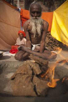 India, Uttar Pradesh, Varanasi, meditating Sadhu - JBA000055