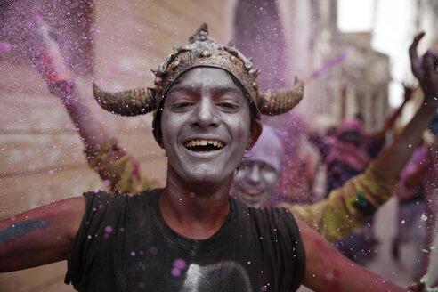 India, Uttar Pradesh, Vrindavan, male teenagers during Holi, spring festival, festival of colours, boy with viking helmet - JBA000034
