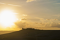 Italy, Tuscany, Val d'Orcia, Rolling landscape at sunset - MJF000837