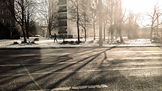 Woman jogging in the winter in the city, Germany, Berlin - CM000045