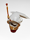 White coffee cup with white coffee and saucer falling in front of white background - AKF000302
