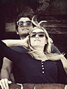 Portrait of young couple wearing sunglasses - HOHF000411