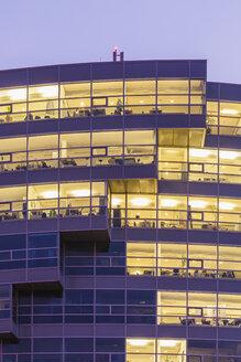 Germany, Baden-Wuerttemberg, Stuttgart, part of facade of office building at twilight - WDF002243