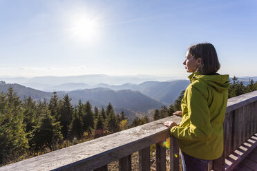 Germany, Baden-Wuerttemberg, Black Forest, Northern Black Forest, Schliffkopf, a woman standing at viewpoint - WDF002276