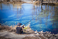USA, Texas, Young boy fishing - ABAF001193
