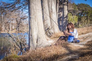 USA, Texas, Mother and son fishing - ABAF001194