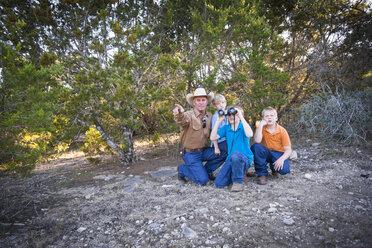 USA, Texas, Man and kids with binoculars - ABAF001211