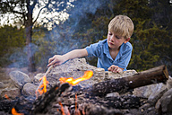 USA, Texas, Boy at camp fire - ABAF001201