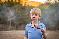 USA, Texas, Boy with barbecue sausage - ABAF001199
