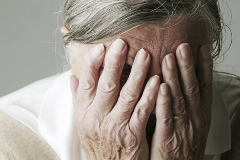 Senior woman covering face with her hands - JATF000635