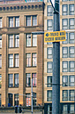 Australia, New South Wales, Sydney, view to facades, street sign upside down in front - FBF000217