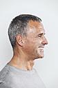 Profile of smiling mature man, studio shot - MFF000844