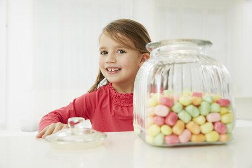 Germany, Munich, Girl with candy jar - FSF000165