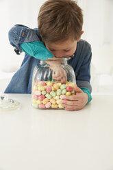 Germany, Munich, Boy with candy jar - FSF000155