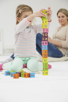 Germany, Munich, Mother playing with daughter - FSF000136