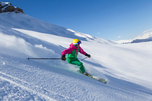 Switzerland, Graubuenden, Obersaxen, female Skier - EG000030