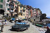 Italy, Cinque Terre, La Spezia Province, Liguria, Riomaggiore, View of fishing boats in the traditional fishing village - AM001788