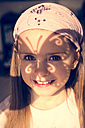 Portrait of smiling little girl with butterfly shaped shadow on her face - SARF000251